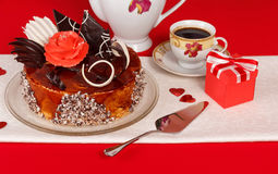 Chocolate cake and cup with gift Stock Photo