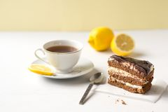 Chocolate cake with a cup of tea. Stock Photo