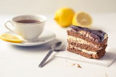 Chocolate cake with a cup of tea. Chocolate cake with a cup of tea on a white background Stock Photos