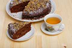 Chocolate cake and cup of tea Royalty Free Stock Photo