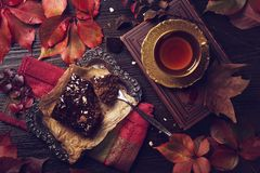 Chocolate cake and a cup of tea. On a wooden background royalty free stock image