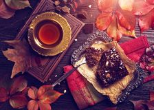Chocolate cake and a cup of tea. On a wooden background royalty free stock photos