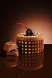 Chocolate cake on a dark background. Gentle chocolate cherry cake and chokolate Royalty Free Stock Photography