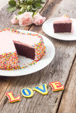 Chocolate cake decorate with pink cream butter and colorful suga Stock Image