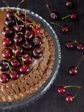 Chocolate cake decorated with cherries Stock Photo