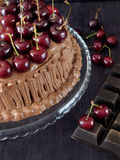 Chocolate cake decorated with cherries Stock Image