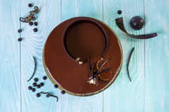Chocolate cake decorated with chocolate on a blue wooden background Stock Photography