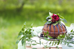 Chocolate cake decorated with flowers Royalty Free Stock Photos