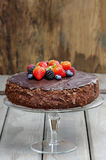 Chocolate cake decorated with fresh fruits Royalty Free Stock Image