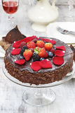 Chocolate cake decorated with fresh fruits Stock Photos