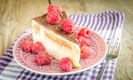 Chocolate cake decorated with fresh raspberries. Close up Stock Image