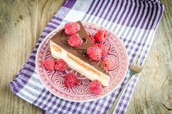 Chocolate cake decorated with fresh raspberries. Close up Royalty Free Stock Images