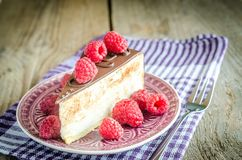 Chocolate cake decorated with fresh raspberries. Close up Stock Photos