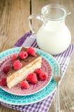Chocolate cake decorated with fresh raspberries. Close up Stock Photo