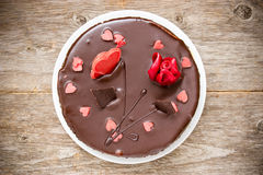 Chocolate cake decorated with  hearts Stock Photos