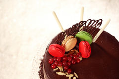 Chocolate cake decorated with macaroons Stock Photo