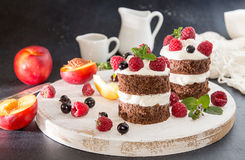 Chocolate cake decorated with raspberry, black currant, nectarin Royalty Free Stock Photo