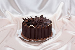 Chocolate cake decorated with shavings and cocoa mousse Royalty Free Stock Photo