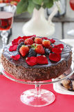 Chocolate cake decorated with strawberries and blackberries. Royalty Free Stock Image