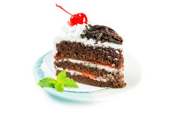 Chocolate cake delicious decorated with whipped cream and cherri Stock Photo