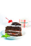 Chocolate cake delicious decorated with whipped cream and cherri Royalty Free Stock Image