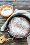 Chocolate cake sprinkled with powdered sugar. stock image