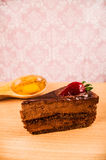 Chocolate cake and egg on a table Royalty Free Stock Images