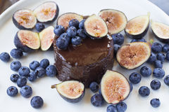 Chocolate cake with figs and blueberries Stock Photo