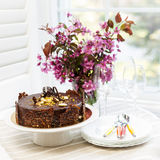 Chocolate cake with flowers stock photography