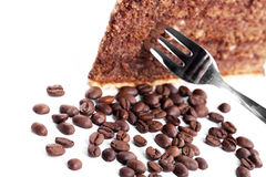 Chocolate cake with a fork and coffee beans Royalty Free Stock Photo