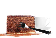 Chocolate cake with a fork and a cup of coffee Royalty Free Stock Photography