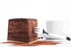 Chocolate cake with a fork and a cup of coffee in Stock Photos