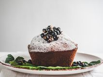 Chocolate cake, fresh berries and vintage plate stock images
