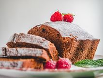 Chocolate cake, fresh berries and vintage plate royalty free stock photos
