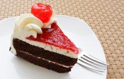 Chocolate cake and fresh cherry. Chocolate cake with fresh cherry Royalty Free Stock Photography