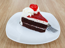Chocolate cake and fresh cherry Stock Images