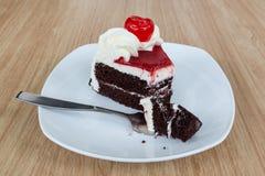 Chocolate cake and fresh cherry. Chocolate cake with fresh cherry Royalty Free Stock Photo
