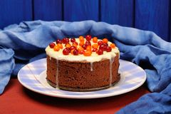Chocolate cake with fresh cranberries, sea-buckthorn and icing d Stock Images
