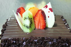 Chocolate cake with fresh fruit decoration Royalty Free Stock Photo