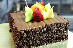 Chocolate cake with fresh fruit decoration Stock Images