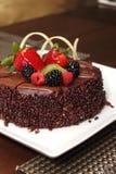 Chocolate cake with fresh fruit decoration. Stock Image