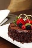 Chocolate cake with fresh fruit decoration. Royalty Free Stock Image