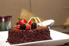 Chocolate cake with fresh fruit decoration. Royalty Free Stock Photos