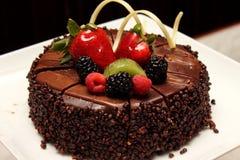 Chocolate cake with fresh fruit decoration. Royalty Free Stock Images