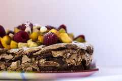 A chocolate cake with fresh fruits and almond Stock Image