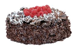 Chocolate cake with fresh raspberries. Isolated on white Royalty Free Stock Photos