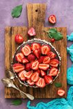 Chocolate cake with fresh strawberries on a beautiful background. Top view, flat lay royalty free stock photo