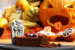 Chocolate cake with fruit in shaped coffin on Halloween day Stock Photography