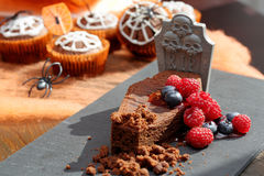 Chocolate cake with fruit in shaped coffin on Halloween day Royalty Free Stock Photography
