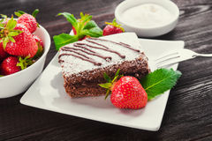 Chocolate cake and fruit strawberry Stock Image
